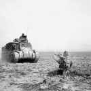 A U.S. Army M-3 Grant of the 1st Armored Division moves forward during the Battle of Kasserine Pass. Inferior equipment and poor leadership led to a U.S. defeat, but also resulted in invaluable lessons for the U.S. Army. U.S. Army photo